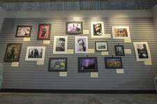 A wall of photography submissions is on display for The Student Art Scholarship Exhibit on Thursday, March 21, 2019 at The Woodlands Arts Council office in The Woodlands. The exhibit showcases several categories of art submitted by students around the area.