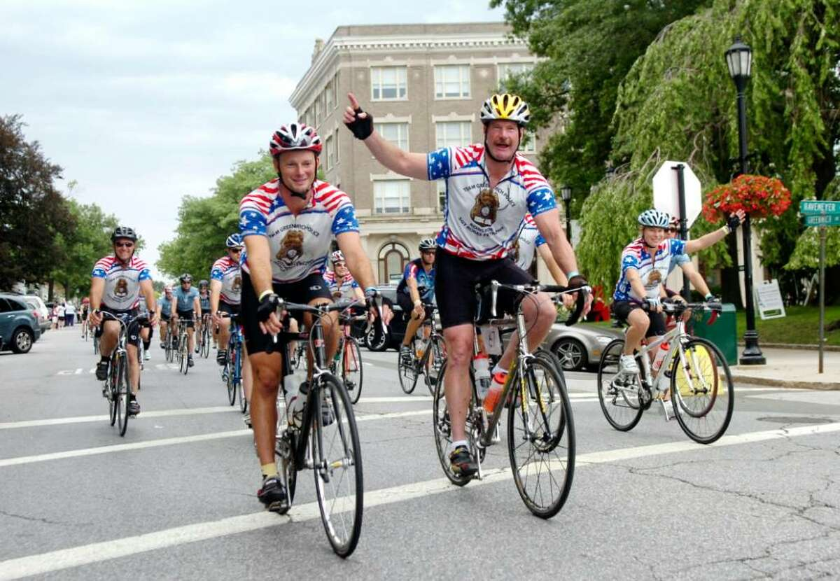 Lt. Richard Cochran, center, and other members of the Greenwich police lead the Victory Ride down Greenwich Avenue in honor of Greenwich officer Sgt. Roger Petrone and in remembrance of Claire Collier and John Blais, all of whom have battled ALS, on Sunday, July 25, 2010. More than 200 cyclists concluded a 270 mile trek from Boston to Connecticut to raise money for the fight against ALS.