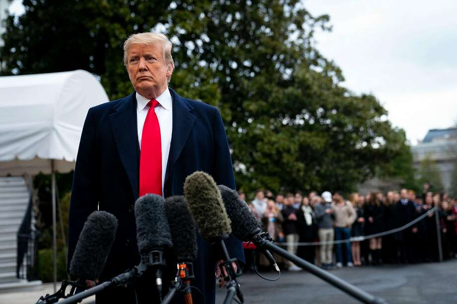 President Trump speaks to reporters Friday at the White House before leaving for his Florida estate. Photo: Doug Mills / New York Times