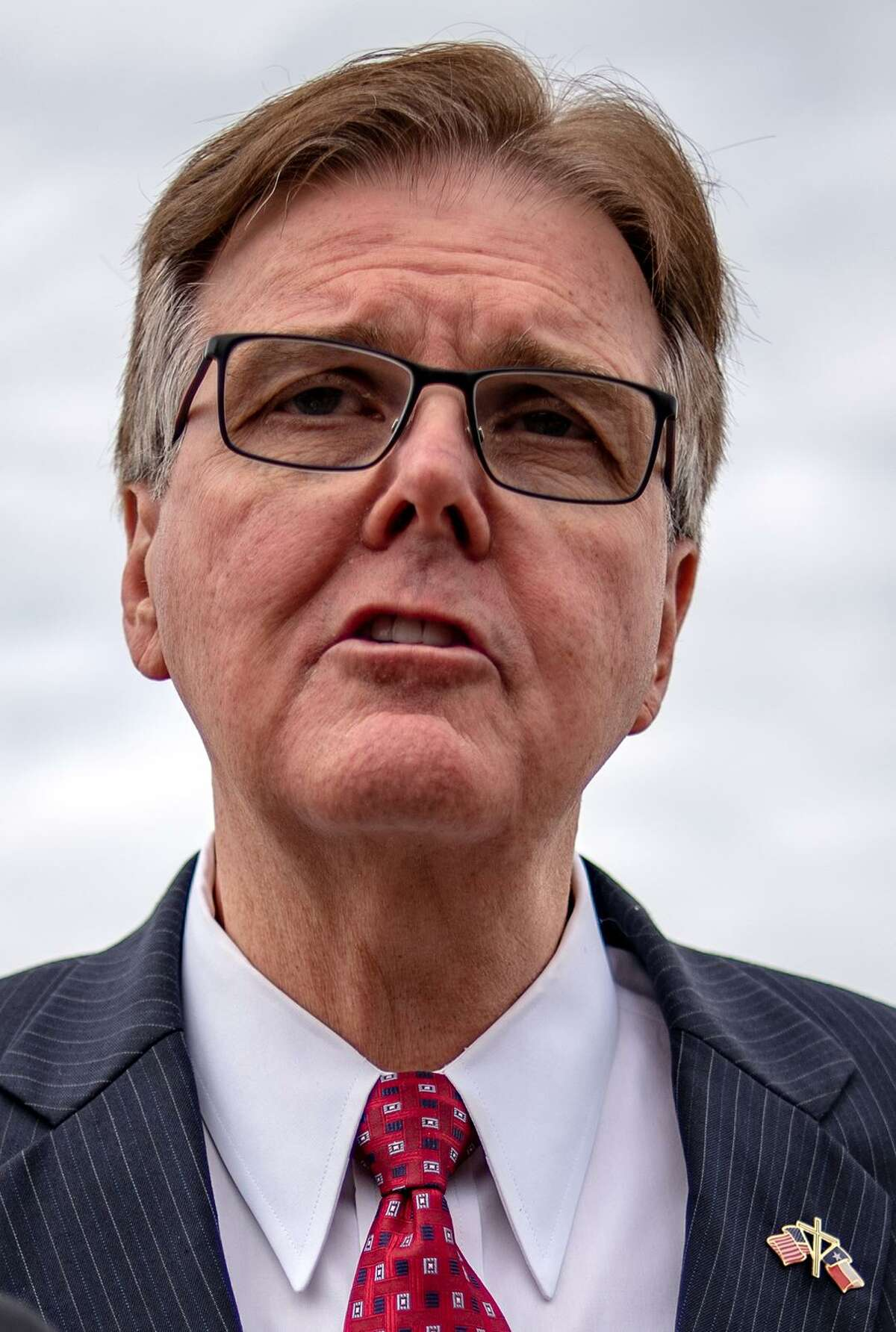 """Dan Patrick, Lt. Governor of Texas, speaks to members of the media at McAllen-Miller International Airport in McAllen, Texas, U.S., on Thursday, Jan. 10, 2019. President Donald Trump's decision to bid """"bye bye"""" to House Speaker†Nancy Pelosi†and storm out of a White House meeting brought relations between the president and Democrats to a new low just as the impact of the nearly three-week government shutdown was set to intensify. Photographer: Sergio Flores/Bloomberg"""