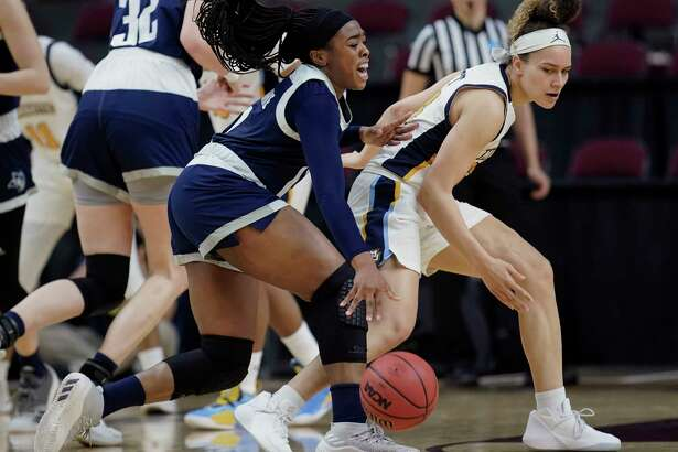 Rice's Erica Ogwumike, left, runs into Marquette's Selena Lott during the first half of a first round women's college basketball game in the NCAA Tournament Friday, March 22, 2019, in College Station, Texas. (AP Photo/David J. Phillip)