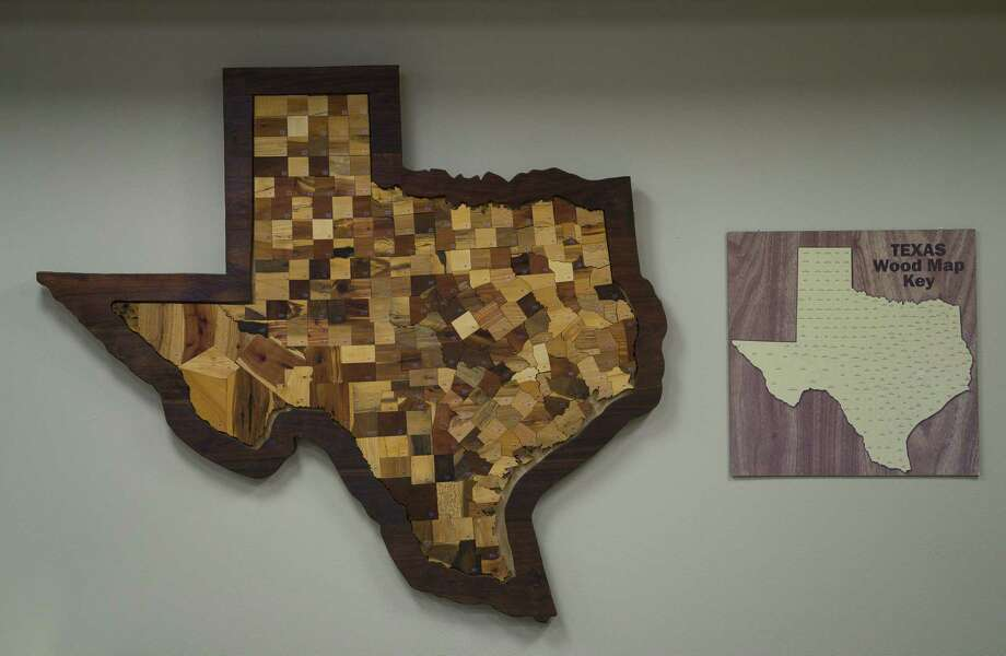 A decorative Texas made out of the woods found in each county hangs on the wall inside the Texas Forestry Association offices in Lufkin, TX, Monday, Feb. 25, 2019. Each different room in the association's building feature's a native Texas wood as an accent wall. Photo: Mark Mulligan, Houston Chronicle / Staff Photographer / © 2019 Mark Mulligan / Houston Chronicle