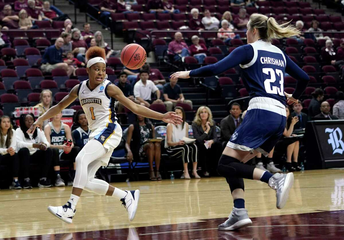 Marquette's Danielle King (1) reaches for a pass as Rice's Alexah Chrisman (23) defends during the first half of a first round women's college basketball game in the NCAA Tournament Friday, March 22, 2019, in College Station, Texas. (AP Photo/David J. Phillip)