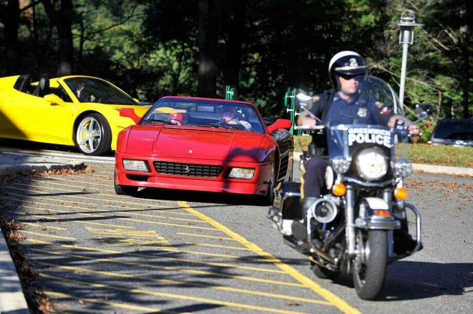 Sam Buck was driven to school in a Ferrari, with a police escort, on his special day in 2015. Photo: / File / Hearst Connecticut Media