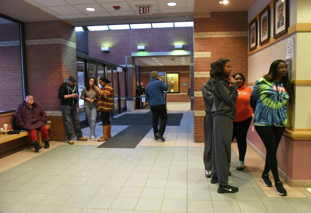 People wait in the lobby for night court at Colonie Justice Court on Wednesday, March 6, 2019 in Latham, N.Y. (Lori Van Buren/Times Union)