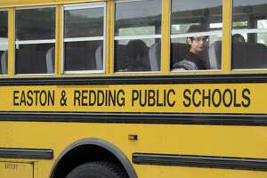 Students at Joel Barlow High School in Redding head for the buses at dismissal time Monday afternoon, June 8. Redding and Easton are considering switicing from diesel to natural gas buses.