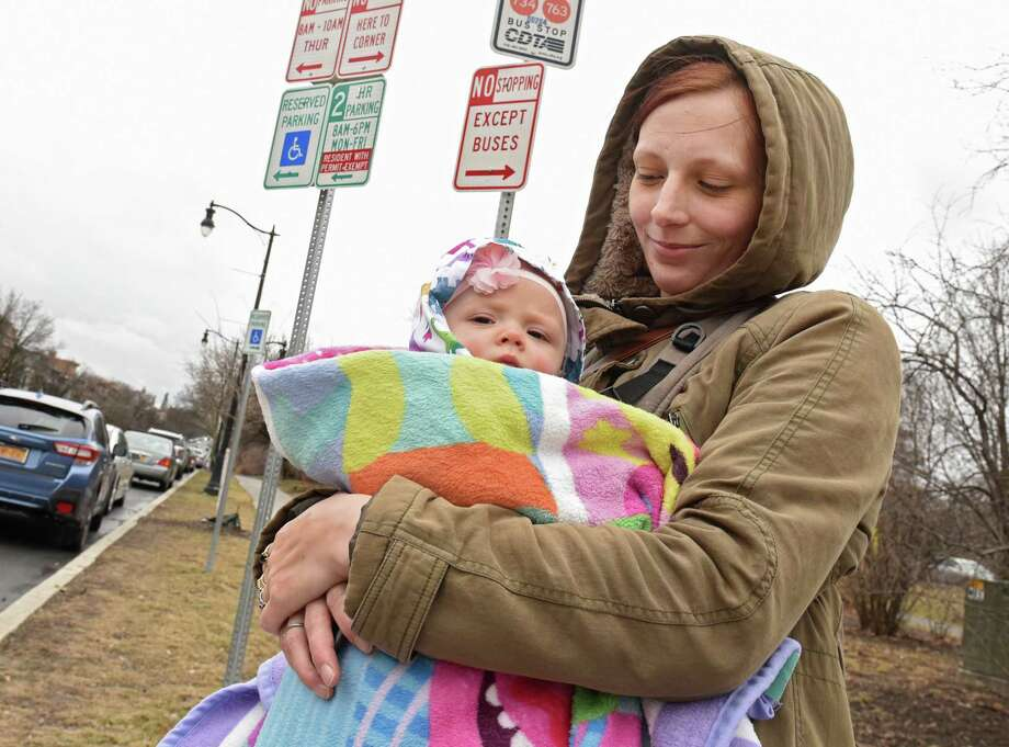 Karin Spindler of Orange County uses a blanket to keep her daughter Anneliese Mead, 6 mos., warm while waiting for a bus on Madison Ave. on Friday, March 22, 2019 in Schenectady, N.Y. (Lori Van Buren/Times Union) Photo: Lori Van Buren, Albany Times Union / 40046504A