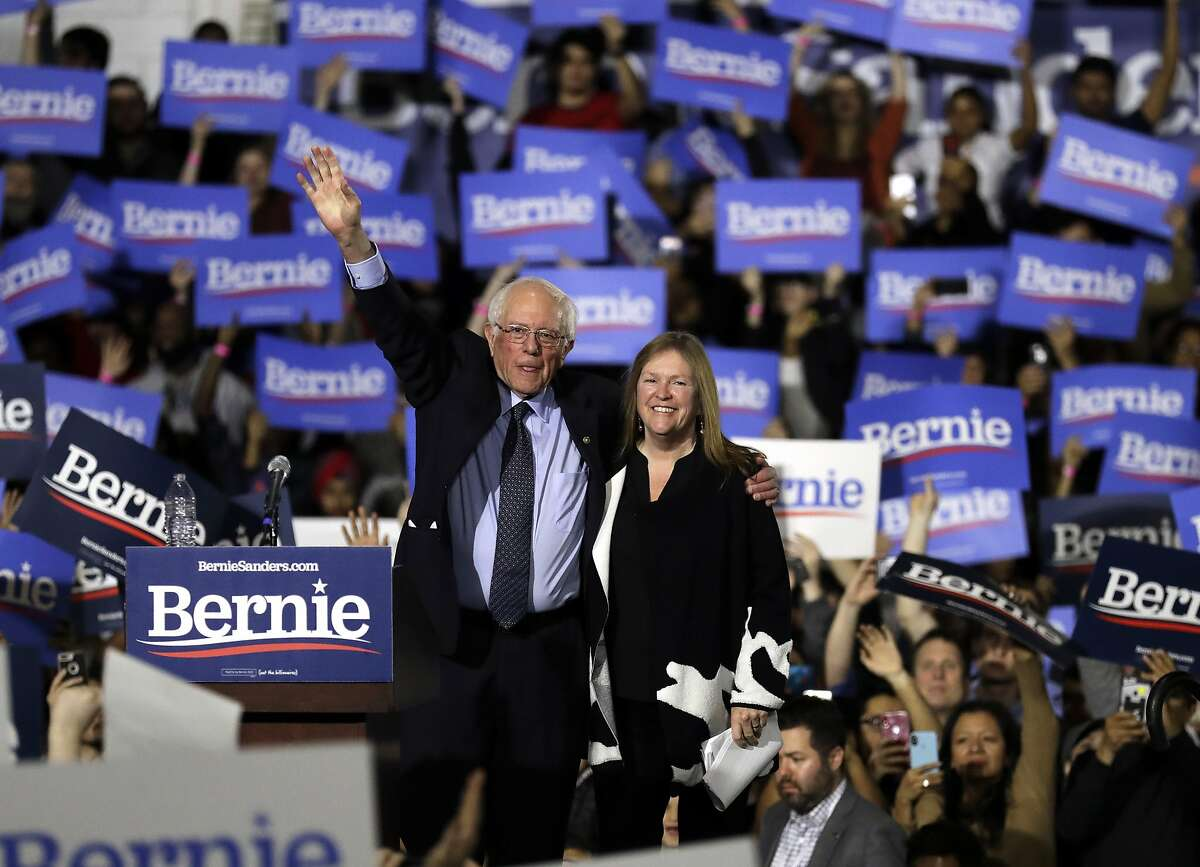 Sen. Bernie Sanders, I-Vt., left, and his wife, Jane O'Meara Sanders, wave to supporters as they leave after his 2020 presidential campaign stop at Navy Pier in Chicago, Sunday, March 3, 2019. Over the next several weeks, Sanders will travel to Iowa, New Hampshire, South Carolina, Nevada, and California. He will then return to Burlington, Vt., for the official launch of his campaign. (AP Photo/Nam Y. Huh)