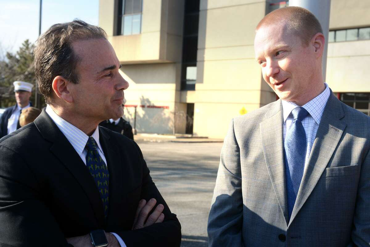 Mayor Joe Ganim, left, speaks with structural engineer Jon Ives, of Aecom Engineering, prior to a press conference at the old Congress Street bridge, in Bridgeport, Conn. Jan. 18, 2019. Ganim announced that plans to replace the bridge are moving forward. Ives is the structural engineer who is designing the new span.