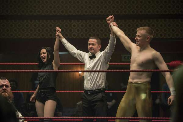 """This image released by Metro Goldwyn Mayer Pictures shows Florence Pugh, left, and Jack Lowden, right, in a scene from """"Fighting with My Family."""""""