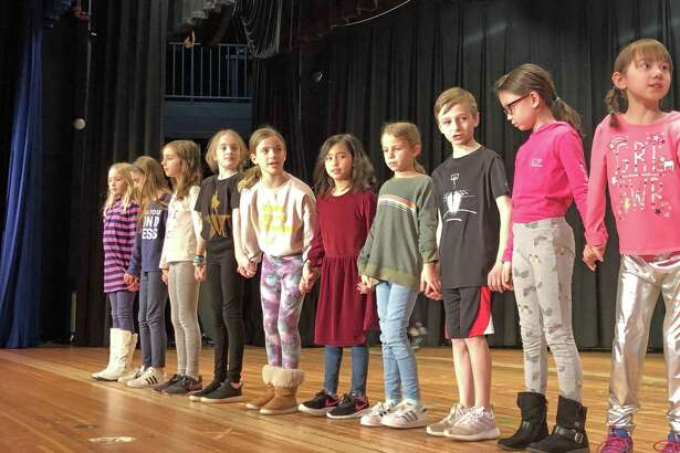 "Students from Saugatuck Elementary School are rehearsing for their production of ""Willy Wonka."" This is the first theatrical production from the newly formed Saugatuck Theater Club. The performances will take place on March 29 at 7 p.m. and March 30 at 2 p.m."