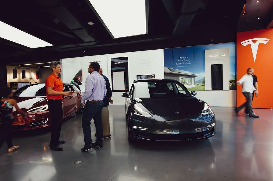 Teslas like the ones in this Los Angeles showroom were popular at the end of last year because of a federal tax credit, but the Palo Alto company's sales have stumbled so far this year. Photo: Rozette Rago / New York Times 2018