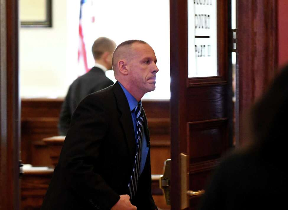 Troy police sergeant Randall French leaves Judge Jennifer Sober's courtroom at the Rensselaer County Courthouse on Wednesday, March 20, 2019, in Troy, N.Y. Sgt. French fatally shot Edson Thevenin during a 2016 DWI traffic stop. He never faced charges after former Rensselaer County District Attorney Joel Abelove allowed him to testify with immunity ?' a move that effectively ended any possible prosecution of the officer. He was in court for an unrelated trail. (Will Waldron/Times Union)