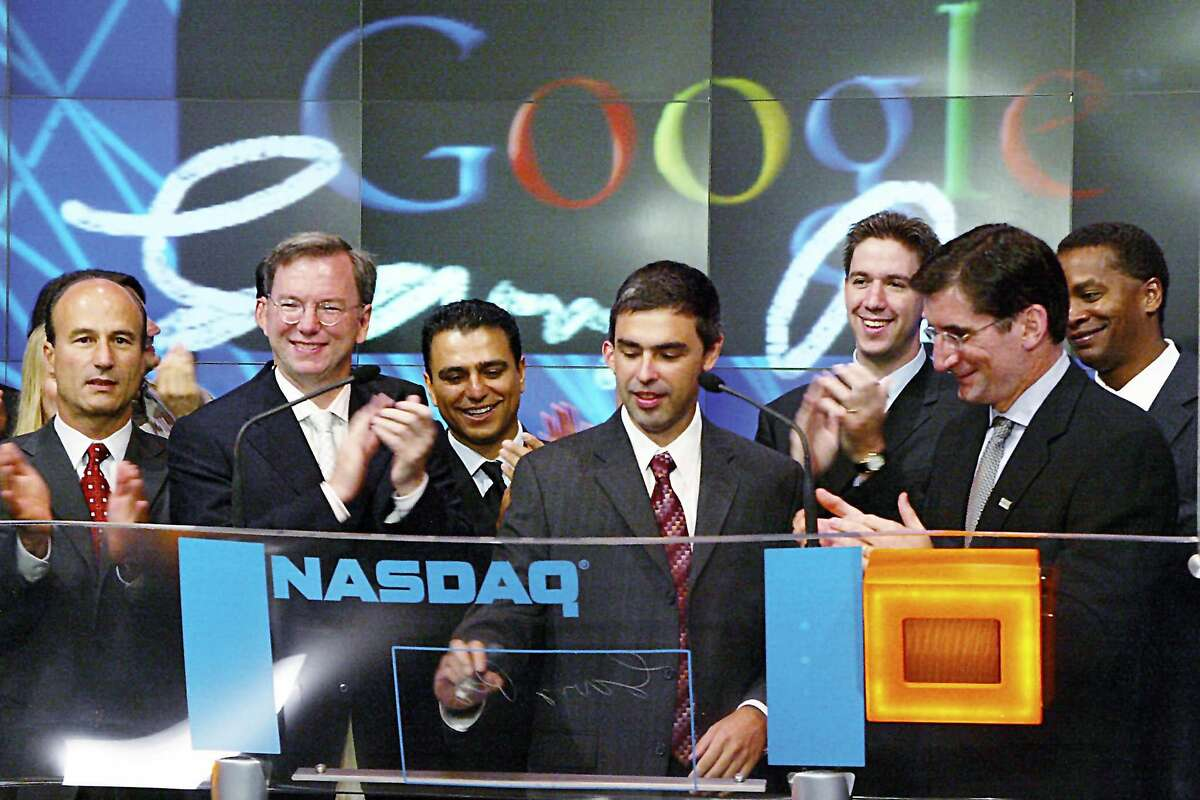 (NYT64) NEW YORK -- August 19, 2004 -- GOOGLE-IPO -- Google Inc.'s co-founder Larry Page is applauded at a ceremony marking the company's initial public offering at the NASDAQ MarketSite in New York on Thursday, August 19, 2004. From left: Google Chief Financial Officer George Reyes; Google CEO Eric Schmidt; Google Senior Vice President Omid Kordestani ; Page; unidentified; NASDAQ President and CEO Robert Greifeld; and Google Vice President David Drummond. (Alan Perlman Foto Associates/NASDAQ/The New York Times) **ONLY FOR USE WITH STORY BY GARY RIVLIN SLUGGED: GOOGLE-IPO. ALL OTHER USE PROHIBITED. **NO SALES ALSO RAN 12/24/04 Ran on: 08-20-2004 Google co-founder Larry Page is applauded by company and Nasdaq officials as the online search engine stock premieres. Ran on: 12-24-2004 At the Nasdaq in New York in August, Googles Larry Page (center), company brass and others gather for the firms IPO. Ran on: 08-14-2005 Larry Page and Sergey Brin, co-founders of Google, have every reason to be smiling, given the meteoric rise of the firms stock in the past year. ALSO Ran on: 08-14-2005 Larry Page and Sergey Brin, co-founders of Google, have every reason to be smiling, given the meteoric rise of the firms stock in the past year.Ran on: 03-01-2006 CFO George Reyes stirs up a commotion with remarks. Ran on: 04-03-2011 Google co-founder Larry Page (center) marks the firms initial public offering in 2004. He replaces Eric Schmidt (second from left) as CEO at a critical time.