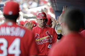 St. Louis Cardinals' Paul Goldschmidt is congratulated by teammates after scoring during the fourth inning of an exhibition spring training baseball game against the Washington Nationals Tuesday, Feb. 26, 2019, in West Palm Beach, Fla. (AP Photo/Jeff Roberson)
