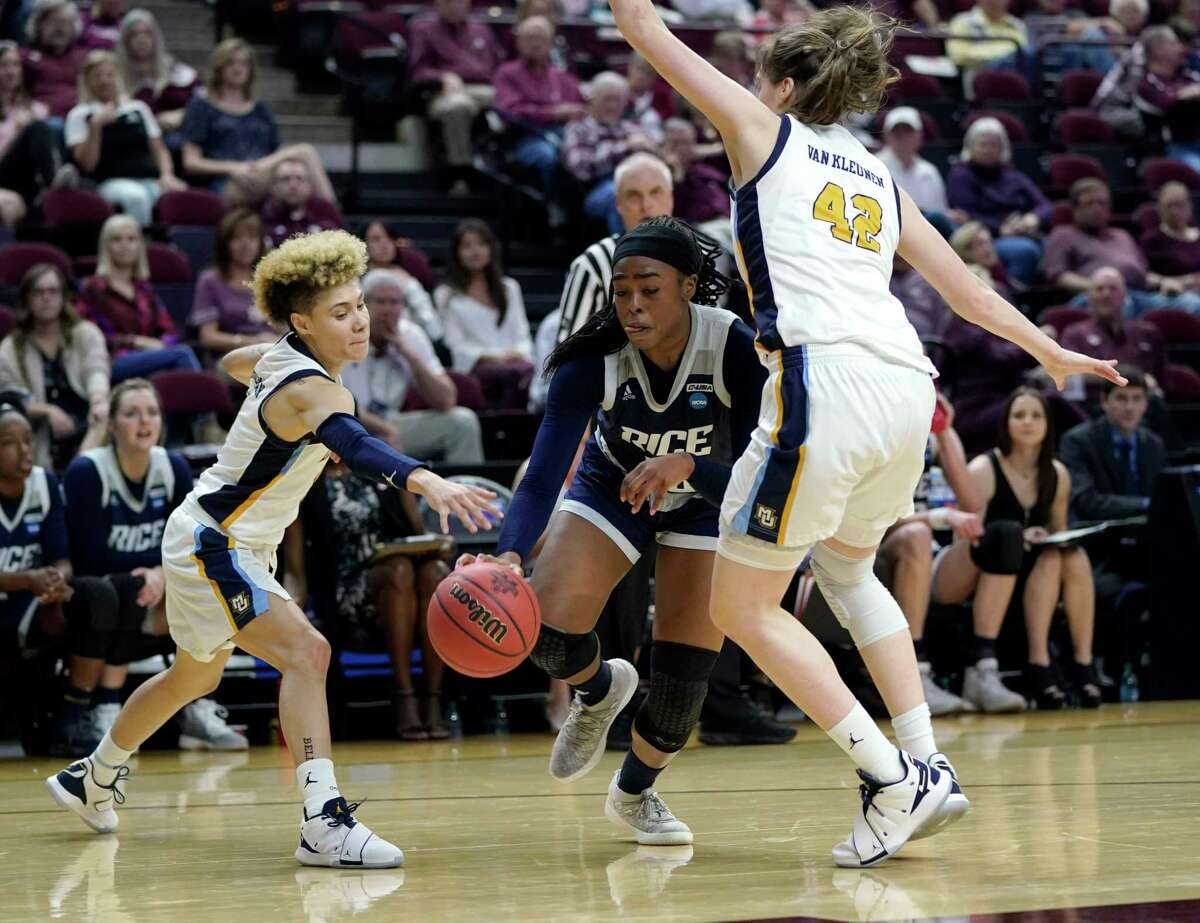 Rice's Erica Ogwumike, center, drives toward the basket as Marquette's Lauren Van Kleunen (42) and Natisha Hiedeman defend during the second half of a first round women's college basketball game in the NCAA Tournament Friday, March 22, 2019, in College Station, Texas. Marquette won 58-54 in overtime. (AP Photo/David J. Phillip)