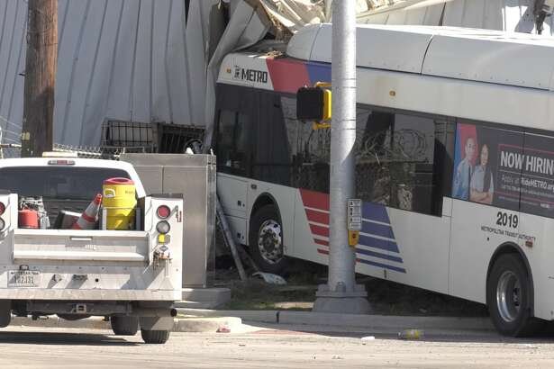 Metro police officers investigate a crash where a Metro bus slammed into the side of a building Friday, March 22, 2019.