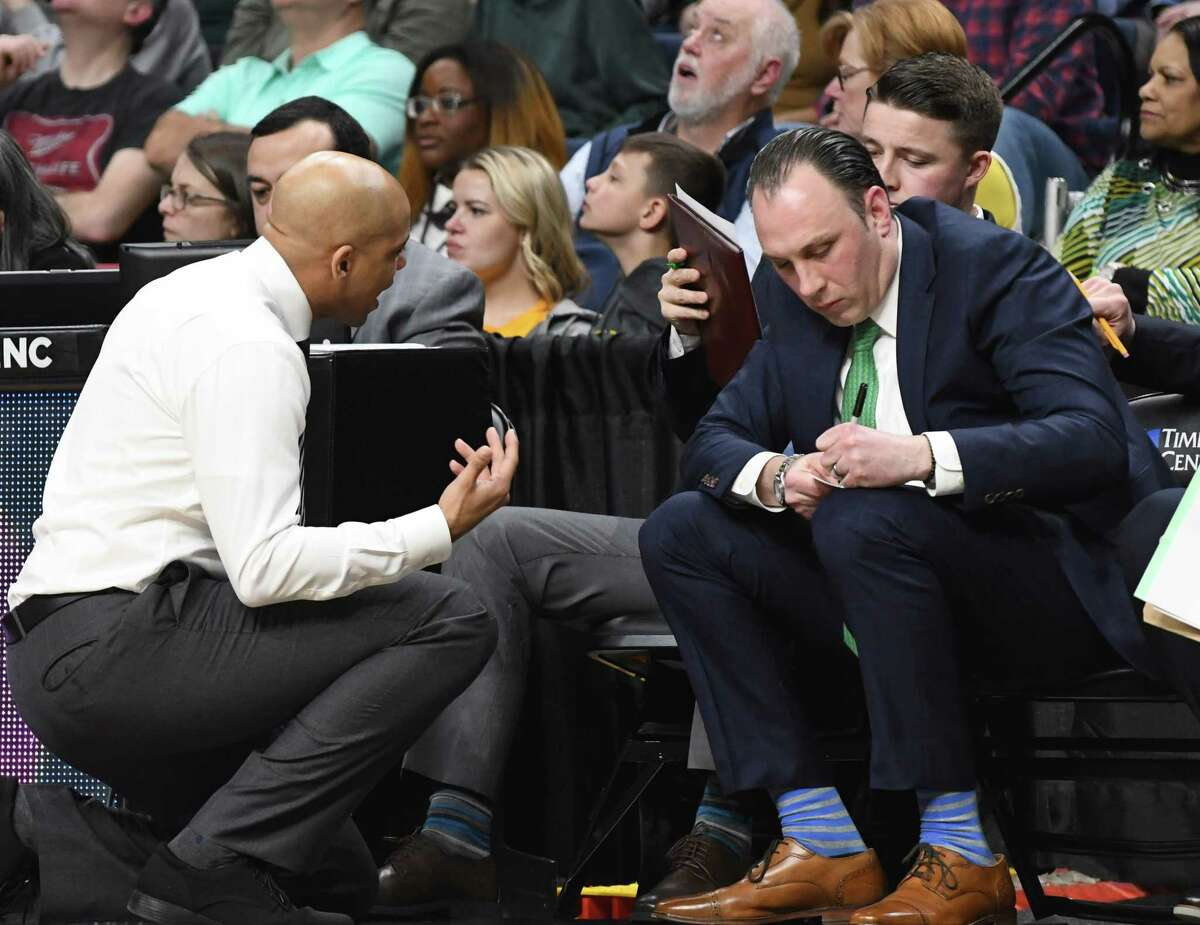 Siena assistant coach Carmen Maciariello, right, works with head coach Jamion Christian during a MAAC quarterfinal game against Rider University on Saturday night, March 9, 2019, at the Times Union Center in Albany, N.Y. Maciariello was named interim head coach after Jamion Christian left to coach the George Washington University team. (Will Waldron/Times Union)
