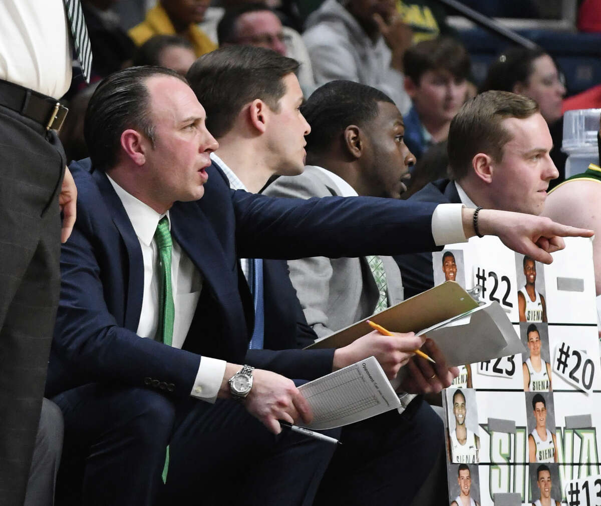 Siena assistant coach Carmen Maciariello points from the sideline during a MAAC quarterfinal game against Rider University on Saturday night, March 9, 2019, at the Times Union Center in Albany, N.Y. Maciariello was named interim head coach after Jamion Christian left to coach the George Washington University team. (Will Waldron/Times Union)