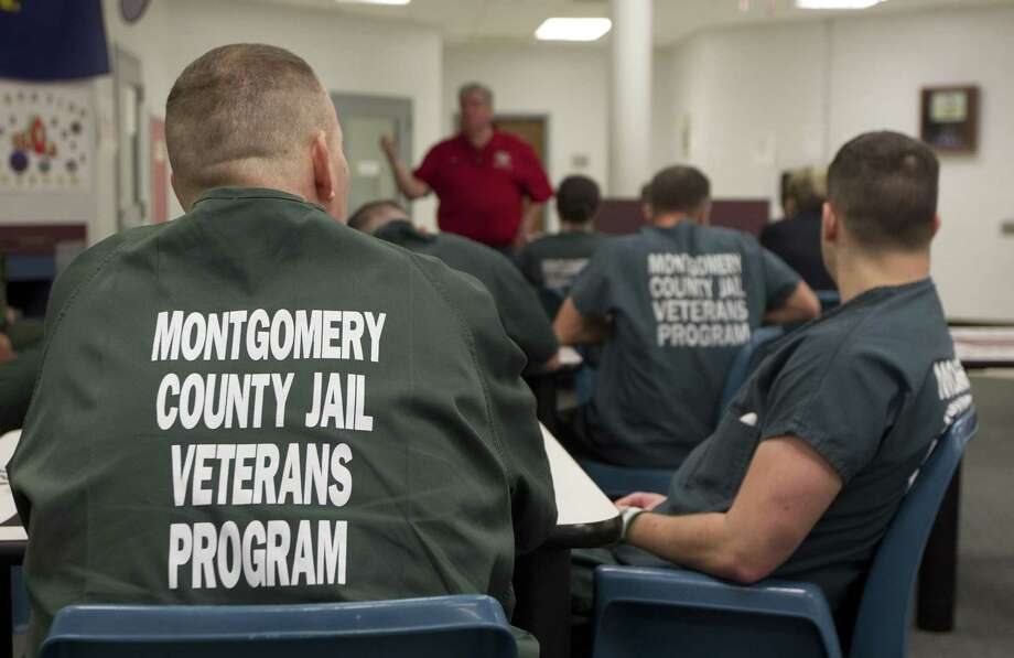 Inmates in the Montgomery County Jail's Pod 7 Veterans Program listen as Rick Pritchard, founder of the Armatus Reintegration Program, speaks, Thursday, March 20, 2019, in Conroe. Pritchard is the founder of the Armatus Reintegration Program, which aims to help integrate incarcerated veterans into society. Photo: Jason Fochtman,  Houston Chronicle / Staff Photographer / © 2019 Houston Chronicle