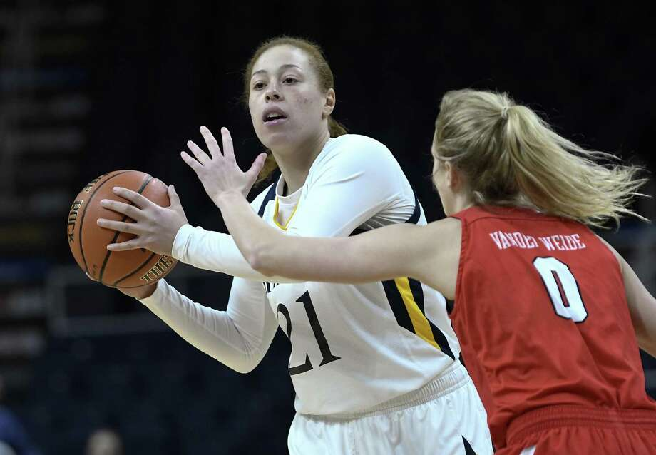 FILE - In this Monday, March 11, 2019, file photo, Quinnipiac forward Jen Fay (21) looks to pass as Marist guard Grace Vander Weide (0) defends during the first half of an NCAA college basketball game in the Metro Atlantic Athletic Conference women's tournament in Albany, N.Y. This 6-foot fifth-year senior scored 20 points in an NCAA Tournament victory over Marquette two years ago during Quinnipiac's Cinderella run to a regional semifinal. (AP Photo/Hans Pennink, File) Photo: Hans Pennink / Associated Press / Copyright 2019 The Associated Press. All rights reserved.