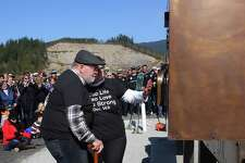 Gail and Ron Thompson look at the facsimile of their old mailbox from their house on Steelhead Drive that is part of a new sculpture, unveiled Friday, as around 150 friends, family, survivors and first responders gathered at the site of the Oso mudslide to remember the 43 loved ones lost five years ago in the deadliest landslide in U.S. history, March 22, 2019. In 2014, mud and debris from the slide destroyed the Steelhead Haven neighborhood, including 49 houses.