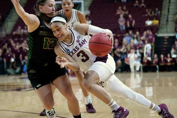Texas A&M's Chennedy Carter (3) drives toward the basket as Wright State's Mackenzie Taylor (12) defends during the first half of a first round women's college basketball game in the NCAA Tournament Friday, March 22, 2019, in College Station, Texas. (AP Photo/David J. Phillip)