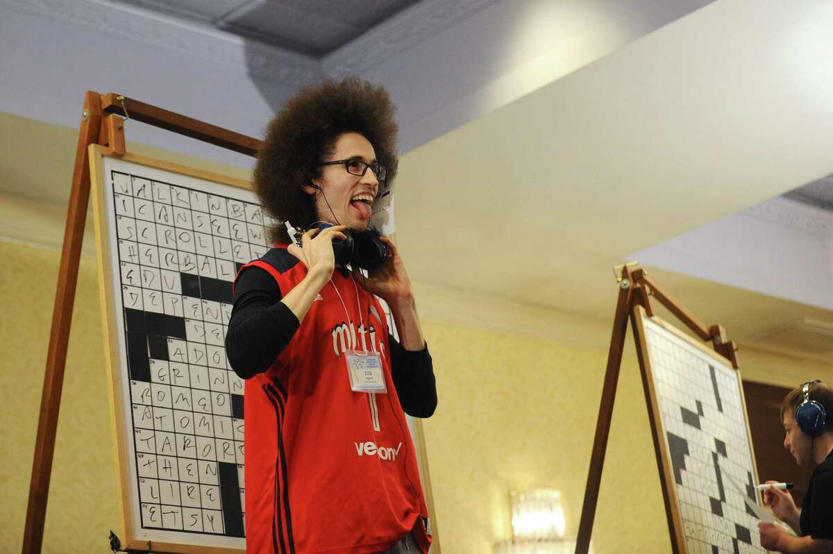Grand champion Erik Agard, of Gaithersburg, Md., reacts after finishing the final puzzle first during the finals of the 41st Annual American Crossword Puzzle Tournament inside the Stamford Marriott in downtown Stamford, Conn. on Sunday, March 25, 2018.