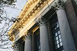 FILE-- A building on campus at Harvard University in Cambridge, Mass., Oct. 26, 2018. A trove of secret files made public in a lawsuit against Harvard outlined a system of admissions preferences and back doors for certain applicants. A 2019 college admissions fraud investigation is just the latest in a string of revelations that have eroded trust in what is portrayed as a meritocratic system.  (Tristan Spinski/The New York Times)