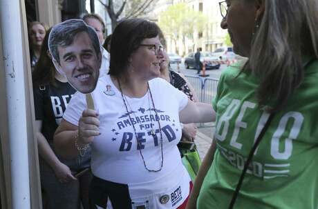 """Jena Carr of Austin holds a cutout of Beto O'Rourke as she joins others waiting in line at the Paramount Theater in Austin for the premier of """"Running with Beto"""" — a documentary of O'Rourke's run for the U.S. Senate as part of the 2019 SXSW Film Festival on Saturday, Mar. 9, 2019. A reader is shocked so many support O'Rourke despite his peculiar past."""