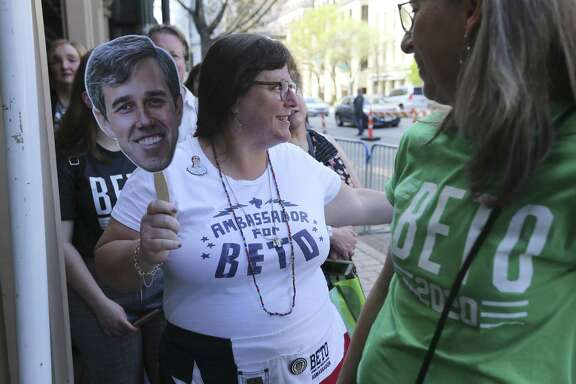 "Jena Carr of Austin holds a cutout of Beto O'Rourke as she joins others waiting in line at the Paramount Theater in Austin for the premier of ""Running with Beto"" — a documentary of O'Rourke's run for the U.S. Senate as part of the 2019 SXSW Film Festival on Saturday, Mar. 9, 2019. A reader is shocked so many support O'Rourke despite his peculiar past."