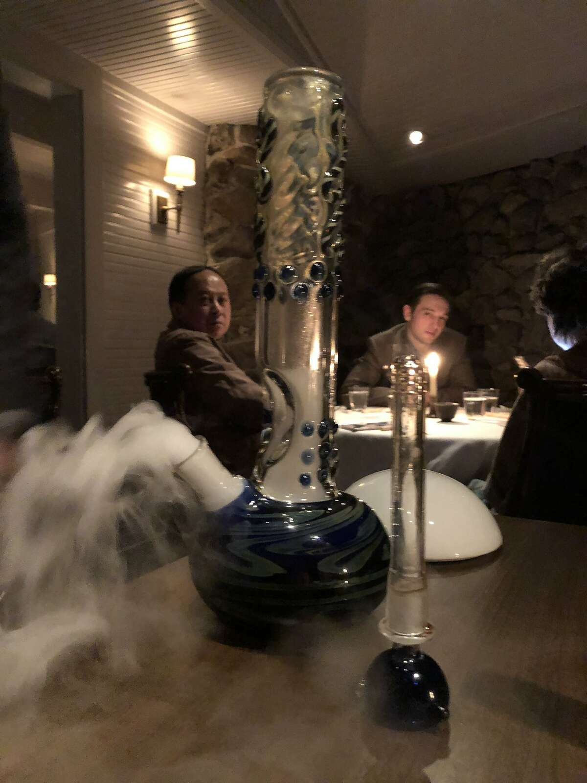 A glass bong full of porcini mushroom broth and smoke at The French Laundry in Yountville, CA.