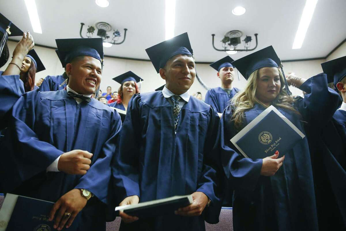 In this June 2018 file photo, Liberty High School senior Elvis Martinez, 17, center, smiles after moving his tassel with his classmates as they graduate during a ceremony at Houston Baptist University. Liberty High School was one of 44 Houston ISD campuses to receive added support in the first year of Achieve 180, the district's $16-million school improvement plan. (Michael Ciaglo / Houston Chronicle)