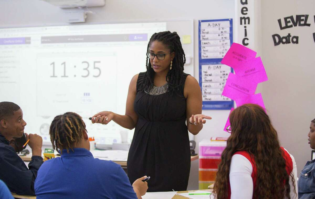 In this September 2018 file photo, Jennifer Charles teaches in her new classroom at Houston ISD's Booker T. Washington High School, Wednesday, Sept. 19, 2018 in Houston. Washington High School and several other HISD campuses under the district's $16-million school improvement plan, known as Achieve 180, still struggled academically despite added investments.