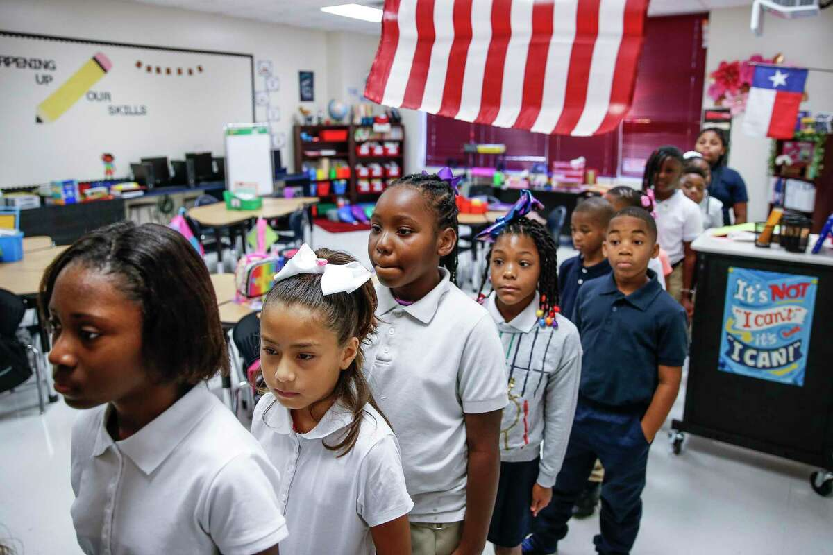 Hilliard Elementary School third grade students line up in their classroom during the first day of school as students return to the school for the first time since Hurricane Harvey Monday Aug. 27, 2018 in Houston. The school underwent $5 million in repairs after the hurricane filled the school with more than four feet of water.