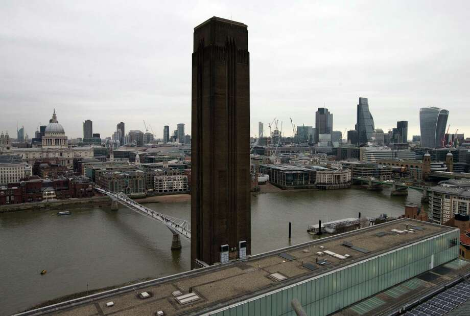 The chimney of the Tate Modern is pictured in front of the River Thames and the City of London skyline from the top of the extension of the Tate Modern in London, England. The Tate group has announced that will no longer accept contributions from the Sackler family, which owns Purdue Pharma. Photo: Carl Court / Getty Images / online_yes