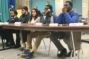 Student Representatives to the Bridgeport Board of Education sit silent through most of the March 11, 2019 business meeting. Their reports have been moved to a quarterly program announced last minute. School officials were not allowed to discuss the program at all on Friday. It will be held Monday.