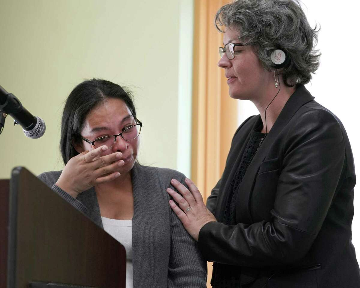 Emeralda Velasquez, left, is comforted by Kate Vickey, excutive director of Houston Immigration Legal Services Collaborative, as she began to cry while speaking about Harvey's impact on her family during the presentation of the Humanitarian Action Plan by the Houston Immigration Legal Services Collaborative held at BakerRipley, 6500 Rookin St., Friday, March 22, 2019, in Houston.