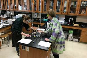 Annika Morgan and Katherine Nuzzo work together in a science classroom at Joel Barlow High School. Both are finalists for the Women of Innovation Awards.