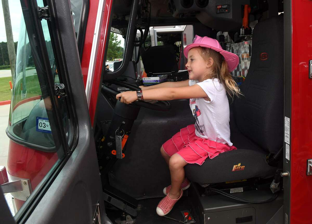Aly Thatcher, 5½, of Cypress, tries out the driver's seat of a fire engine at the Spring Fire Dept. Station 71's Sensory Friendly Special Day on Oct. 13, 2018.