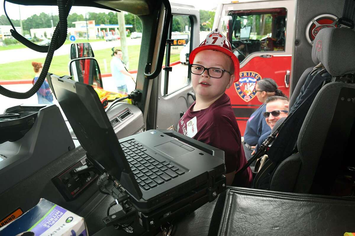 Braden Bull, 9, of Spring, tries on for size the front seat of the heavy rescue engine at the Spring Fire Dept. Station 71's Sensory Friendly Special Day on Oct. 13, 2018.