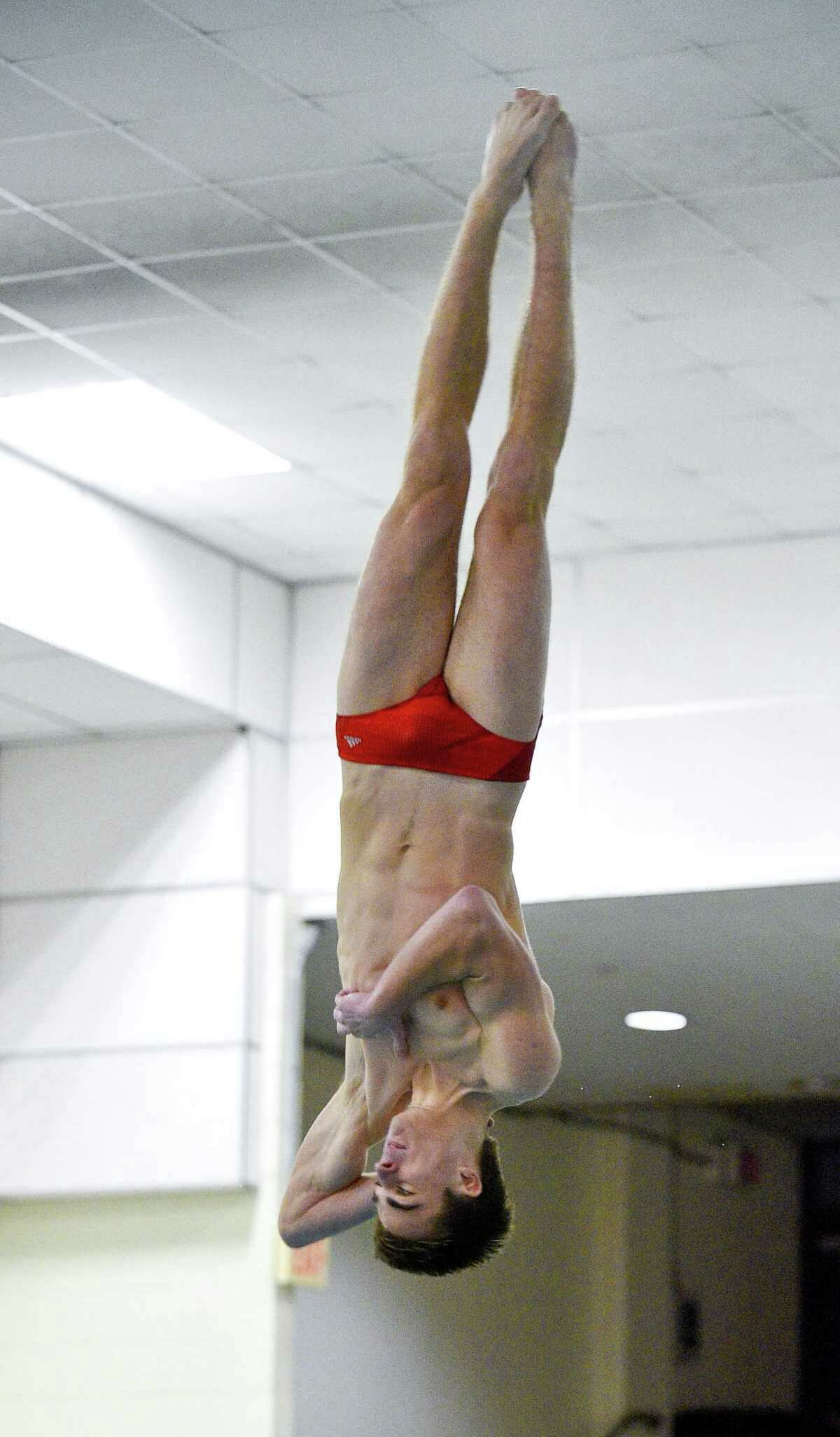McMahon-Norwalk diver Kevin Bradley competes during an FCIAC meet against Westhill-SHS on Jan. 17, 2018.