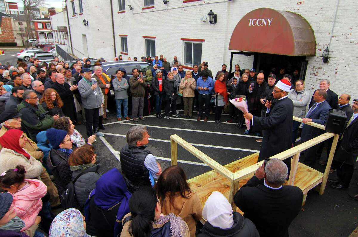 Islamic Cultural Center's Imam Nour shows a bouquet of flowers at the center on Friday that were left at the center during a rally in support of the victims of the massacre at a mosque in Christchurch, New Zealand, last week, in Stamford, Conn., on Friday Mar. 22, 2019. Interfaith Council of Southwestern CT organized the rally in support of Stamford's Muslim community and to foster inter-religious understanding.