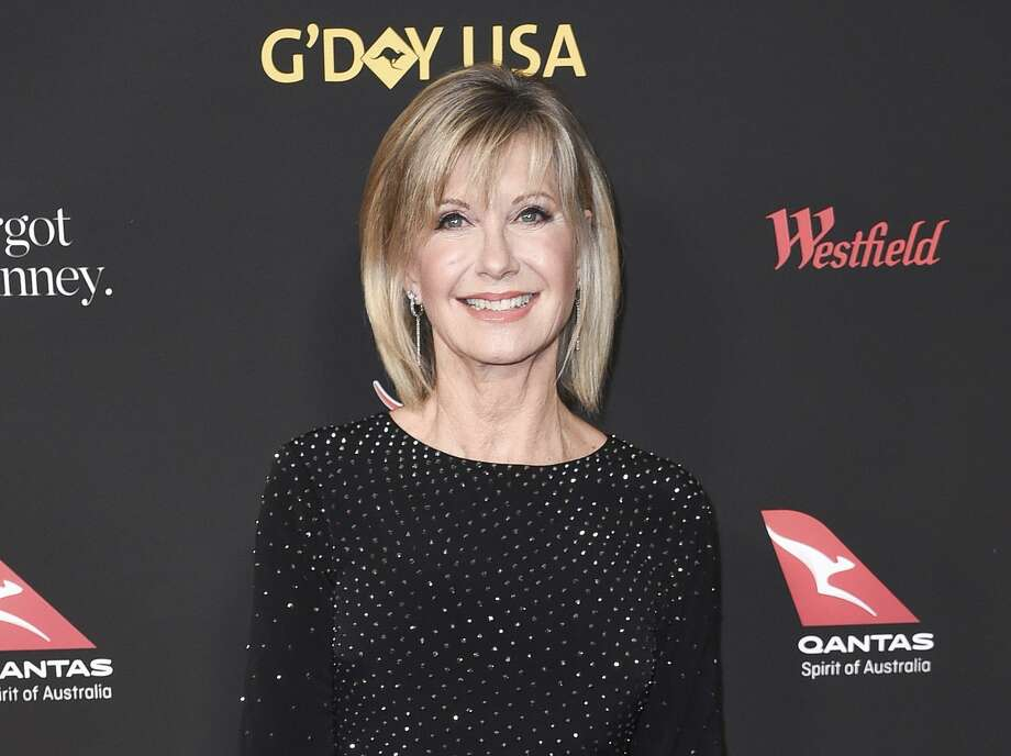 "Olivia Newton-John's autobiography, ""Don't Stop Believin'"" published March 12. Photo: Richard Shotwell, INVL / Associated Press / 2018 Invision"