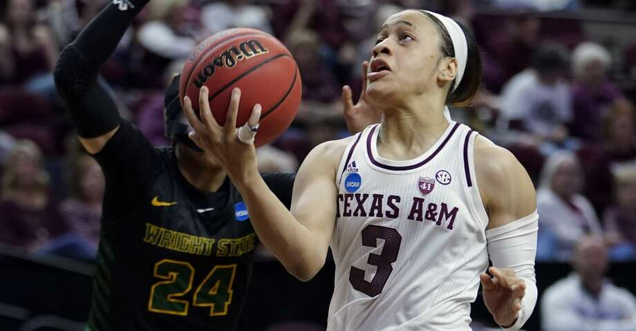 Texas A&M's Chennedy Carter (3) goes up or a shot as Wright State's Michal Miller (24) defends during the first half of a first round women's college basketball game in the NCAA Tournament Friday, March 22, 2019, in College Station, Texas. (AP Photo/David J. Phillip) Photo: David J. Phillip/Associated Press