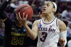 Texas A&M's Chennedy Carter (3) goes up or a shot as Wright State's Michal Miller (24) defends during the first half of a first round women's college basketball game in the NCAA Tournament Friday, March 22, 2019, in College Station, Texas. (AP Photo/David J. Phillip)