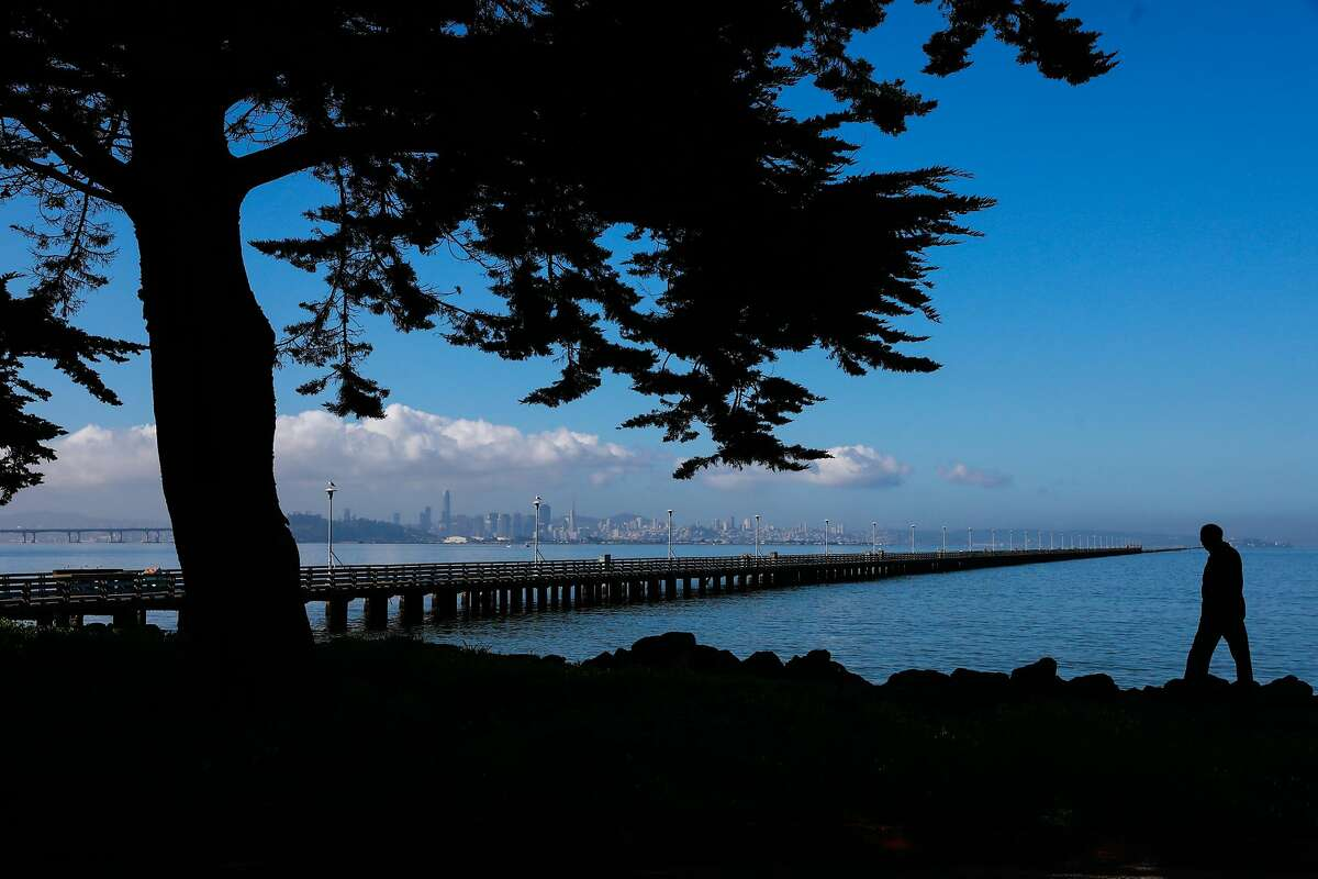 A person walks past a historic pier in Berkeley, California, on Thursday, March 21, 2019.