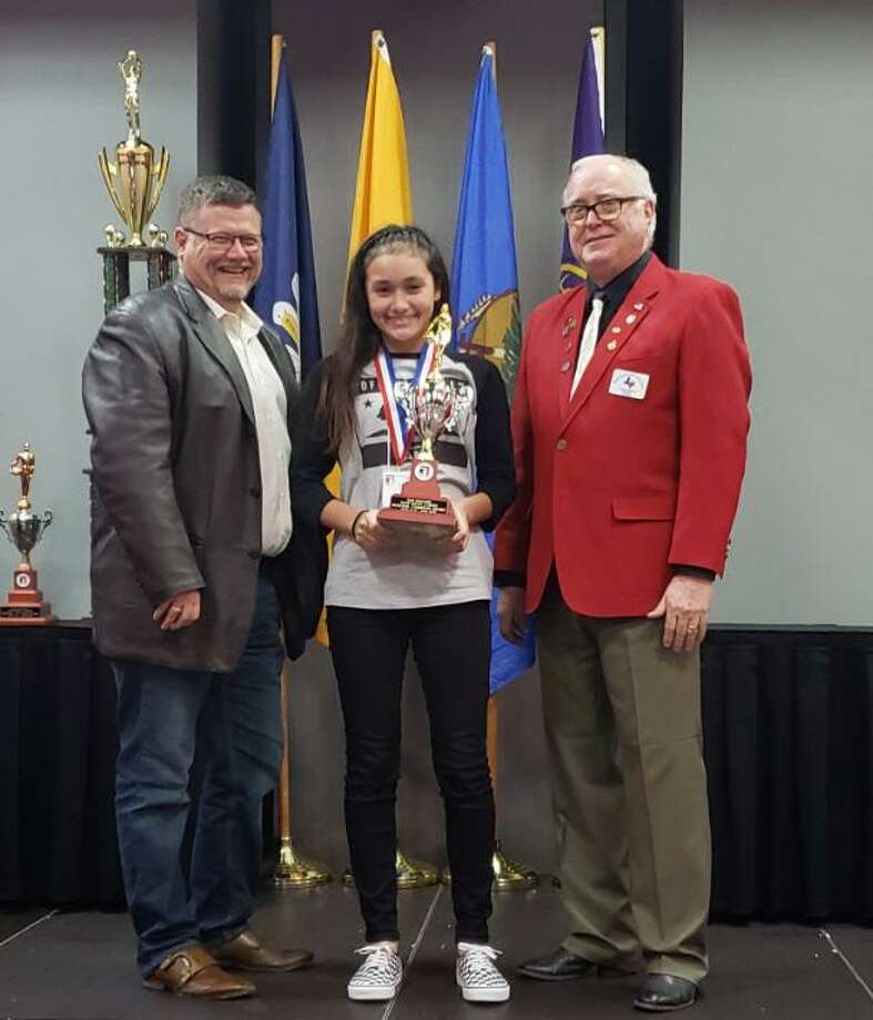 Rihanna DeLeon of Katy is advancing for the second consecutive year to the national finals of the Elk Hoop Shoot Free Throw Contest. With her, from left, are: Kelly Mcdermott, the Elks State Hoop Shoot director, and Fred Adams the Texas Elks State president. DeLeon finished fourth in the national finals last year. Visit elks.org/hoopshoot for information. Photo: Texas Elks State Association / Texas Elks State Association