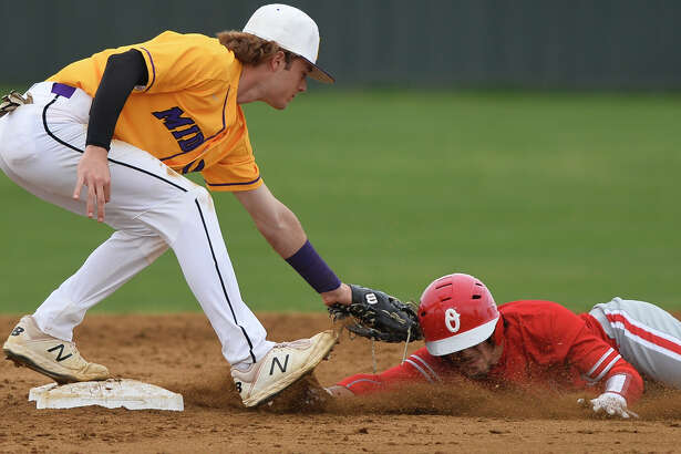 Midland High's Tyler Wade gets an out at second base against Odessa High's Charles McClure March 22, 2019, at Zachery Field. James Durbin / Reporter-Telegram