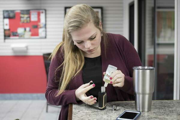 Shellbey Knight refills her e-cigarette with e-juice at the Texas Vape Store off of Austin Highway on Monday, January 23, 2017 in San Antonio, Texas. A bill with bipartisan support in the Texas Legislature would raise the age at which one can buy tobacco products and e-cigarrettes from 18 to 21 years old.